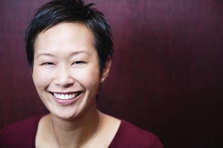 asian women: Headshot of woman smiling at camera