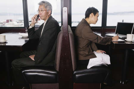 cell phone booth: Two businesspeople in restaurant