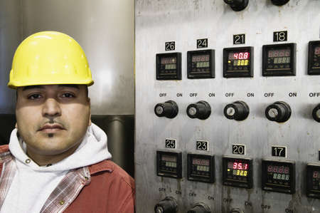 Man beside control panel Stock Photo - 16070893