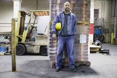 Man standing in warehouse Stock Photo - 16070895