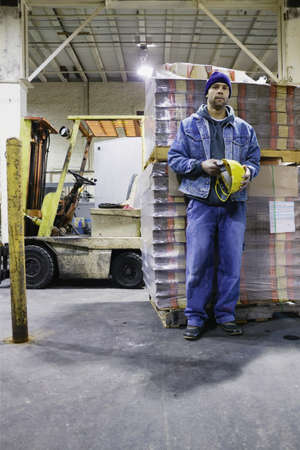 Man standing in warehouse Stock Photo - 16043284