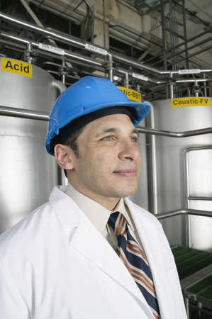 Portrait of man wearing hardhat and lab coat Stock Photo - 16070896