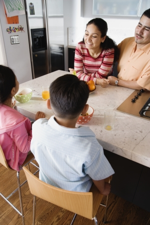 kitchen counter: Family gathered around kitchen counter