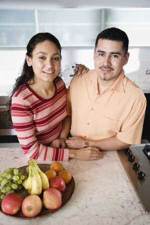 Young couple in kitchen looking at camera Stock Photo - 16070918