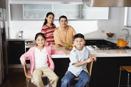 some under 18: Portrait of family in domestic kitchen