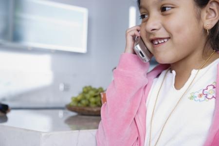 Girl talking on mobile phone Stock Photo - 16070923