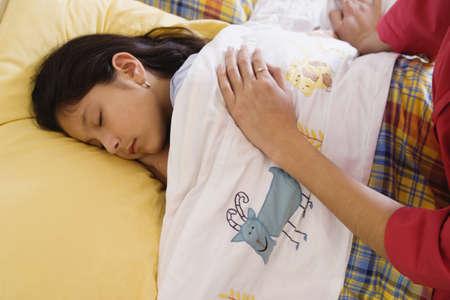 Mother watching daughter sleep Stock Photo - 16070930