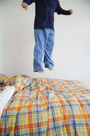 all under 18: Boy jumping on bed