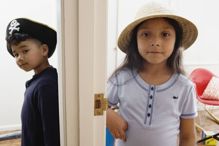 Boy and girl wearing hats