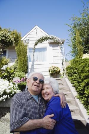 Senior man and women embracing