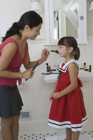Mother and daughter preparing for day