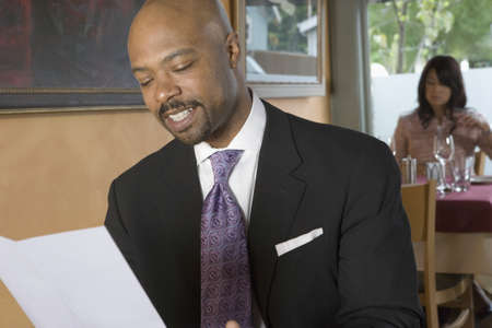 Man reading restaurant menu