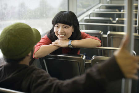 recreational vehicle: Two young adults talking on train