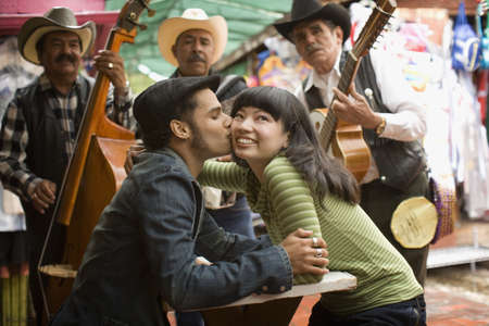 serenading: Young couple with Mariachi band LANG_EVOIMAGES