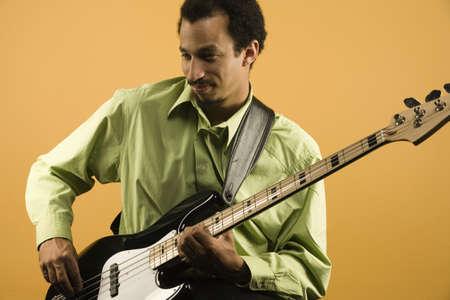 Man playing electric bass guitar Stock Photo - 16071003