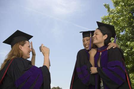 Female graduates taking pictures Stock Photo - 16071011