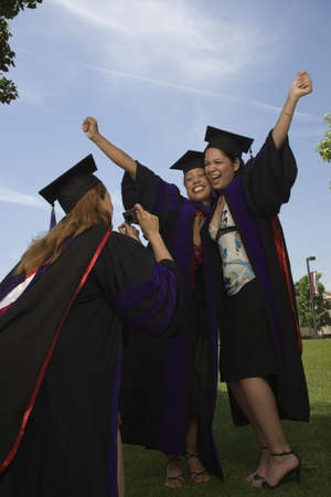 Female graduates taking pictures Stock Photo - 16071014