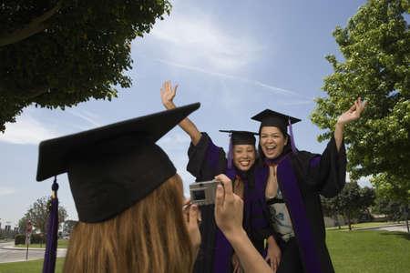 Female graduates taking pictures Stock Photo - 16071015