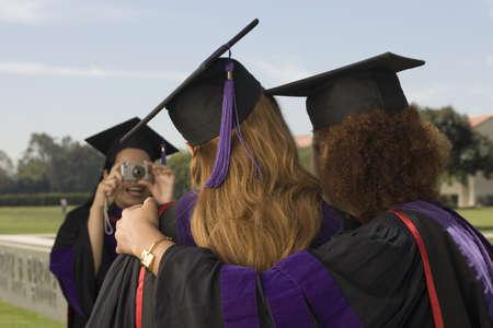 Female graduates taking pictures Stock Photo - 16071017