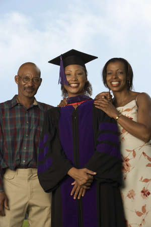 Female graduate with parents Stock Photo - 16071025