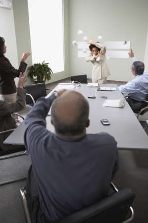throw paper: Businesspeople throwing paper balls