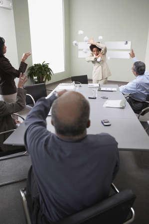 disagreement: Businesspeople throwing paper balls
