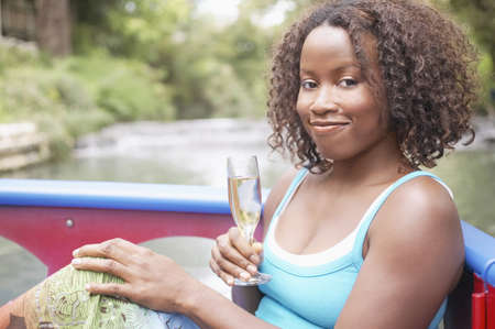 water feature: Woman on a boat holding a glass of wine