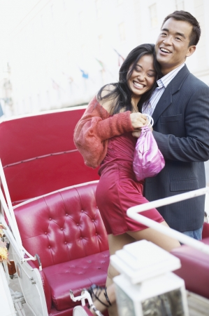 captivated: Couple embracing in carriage