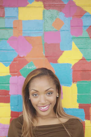 Young woman posing in front of a colorful wall Stock Photo - 16071137