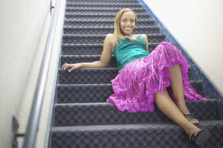 Young woman reclining on staircase Stock Photo - 16071144