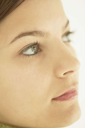 far away look: Closeup of a young womans face