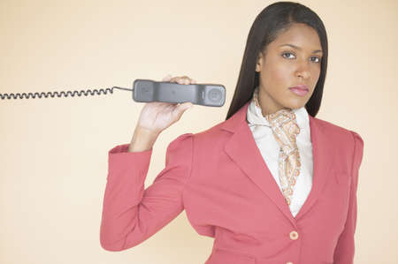receiver: Woman holding a telephone receiver
