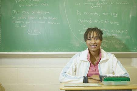 Teenage girl sitting in classroom Stock Photo - 16071227
