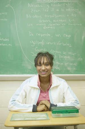 all under 18: Teenage girl sitting in classroom
