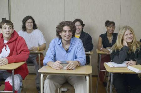 school desk: High school students sitting in classroom