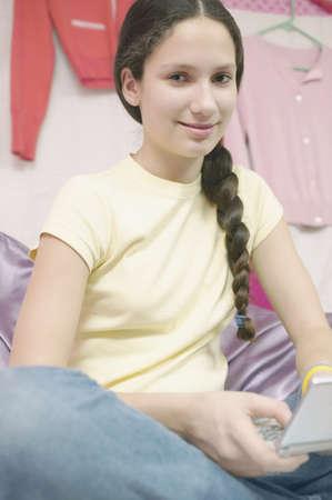 teenaged: Teenage girl holding a video game