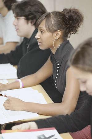 school desk: Four high school students in classroom