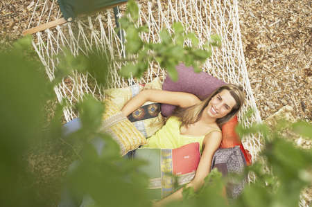 above 18: Young woman resting on hammock
