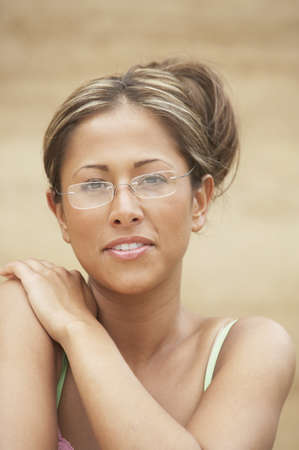 above 25: Portrait of a young woman wearing eyeglasses