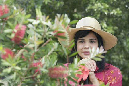 gardening gloves: Portrait of woman holding gardening gloves