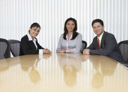 Three business professionals sitting at table Stock Photo - 16071358