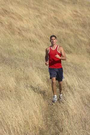 Male runner in golden field Stock Photo - 16071371