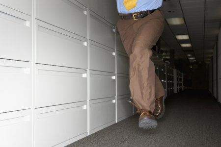 Businessman fleeing office Stock Photo - 16071378