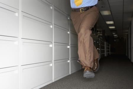 Businessman fleeing office Stock Photo - 16071378