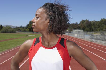 participant: Portrait of female track and field participant LANG_EVOIMAGES