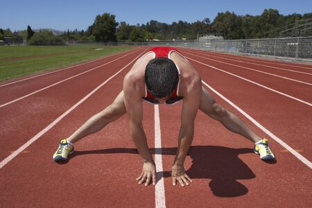 Male track runner stretching Stock Photo - 16071385