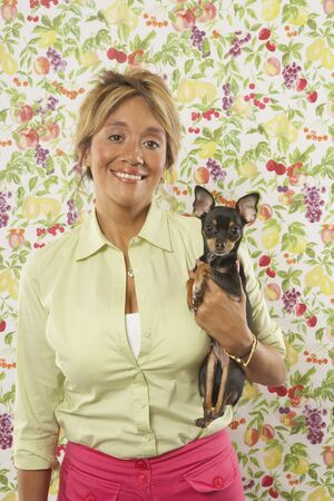 Portrait of woman with pet Chihuahua Stock Photo - 16071389