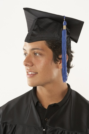Portrait of male graduate in cap and gown Stock Photo - 16071394