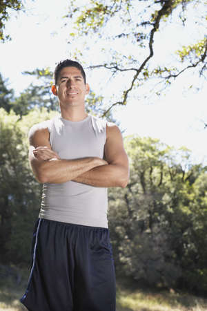 Man standing outside with folded arms Stock Photo - 16071396