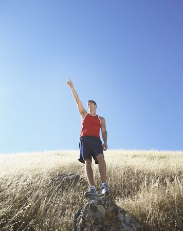 Male athlete gesturing in the countryside Stock Photo - 16071399